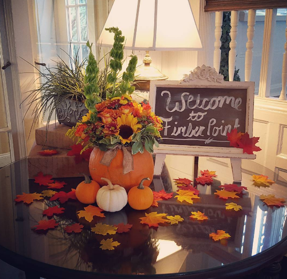 [Image: Decorate your entryway with sunflowers, pumpkins, and fall leaves. Looking for other inspiration? Contact us today! ]